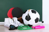 Sports equipment on blackboard background — Stock Photo