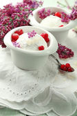 Beautiful composition with tasty ice cream and lilac flowers — Stock Photo
