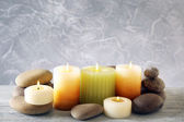 Still life with spa candles on light wallpaper background — Stock Photo