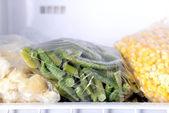 Frozen vegetables in bags — Stock Photo