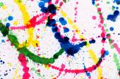 Colorful splashes of paint as background — Stock Photo