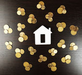 Model of house with coins — Stock Photo