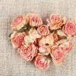 Heart of beautiful dry flowers on sackcloth background — Stock Photo #73054741