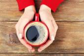Female hands holding cup of coffee — Stock Photo