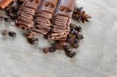 Chopped chocolate on parchment background — Stock Photo