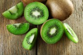 Juicy kiwi fruit on wooden background — Foto de Stock