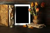 Ancient things and tablet on wooden background — Stock Photo