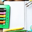 Notebook and bright school stationery on old wooden table — Stock Photo #73088831