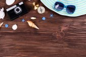 Travel accessories on wooden background — Stock Photo