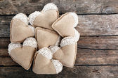 Vintage hearts on wooden background — Stock Photo