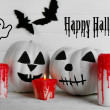 White Halloween pumpkins, candles on white wooden background — Stock Photo #73324935
