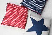 Decorative pillows on plaid close up — Stock Photo