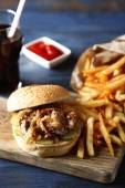 Burger and french fries on plate — Stock Photo
