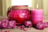 Spa still life with candle and dried roses on wooden table, closeup — Stock Photo