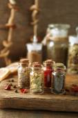 Assortment of spices in glass bottles — Stock Photo
