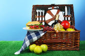 Wicker picnic basket with tablecloth — Stock Photo
