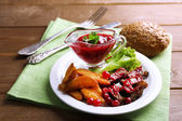 Beef with cranberry sauce — Stock Photo