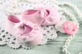 Cute toddler shoes on wooden background — Stock Photo