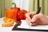 Nutritionist Doctor writing  diet plan in office, closeup — Stock Photo