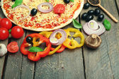 Food ingredients for pizza on table close up — Stock Photo