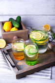 Water with lemon and cucumber — Stock Photo