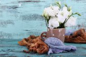 Beautiful flowers in cup on wooden background — Stok fotoğraf
