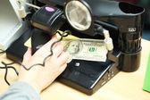 Monetary examination and hand — Stock Photo