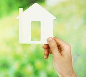 Female hand holding house — Stock Photo
