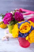 Composition with fresh spring flowers on wooden background — Stock Photo