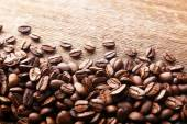 Coffee beans on wooden background — Stock Photo