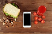Food and mobile phone — Stock Photo