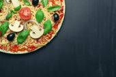 Raw pizza with vegetables on wooden background — Stock Photo