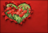 Paper hole ripped in heart shape with tulips background inside — Stock Photo