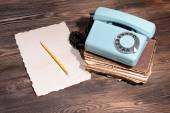 Retro red telephone on table close-up — Stock Photo