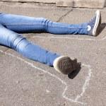 Dead woman laying on asphalt — Stock Photo #74143179