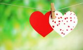 Paper hearts hanging on rope on bright background — Stock Photo