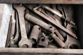 Different tools in box on workplace in garage — Stock Photo