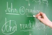 Teacher hand writing grammar sentences on blackboard background — Stock Photo