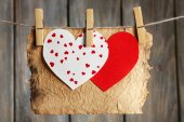 Bright hearts and card hanging on rope — Stock Photo