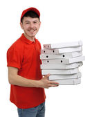 Delivery boy with cardboard pizza box isolated on white — Stock Photo