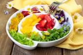 Light organic salad with flowers — Stock Photo