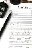 Car keys on insurance documents, close up — Stock Photo