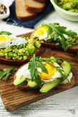 Tasty sandwiches with egg, avocado and vegetables — Stock Photo