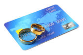 Golden wedding rings and credit card — Stock Photo
