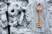 Old key on wooden antique door close-up — Stock Photo
