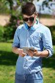 Man with headphones outdoors — Stock Photo