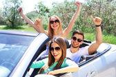 Three friends in cabriolet, outdoors — Fotografia Stock