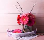 Beautiful bright gerberas in vase on wooden background — Stock Photo