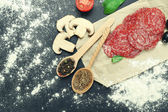 Food ingredients for cooking on wooden background — Stock Photo