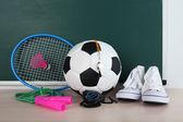 Sports equipment on blackboard — Stock Photo